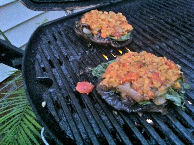 portabella mushrooms with olive tapenade on grill